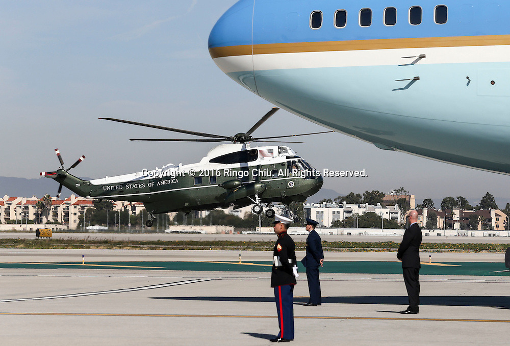 Marine One lands next to Air Force One sitting on the tarmac before President Barack Obama boarding at Los Angeles International Airport in Los Angeles, Friday, Feb 12, 2016.(Photo by Ringo Chiu/PHOTOFORMULA.com)<br /> <br /> Usage Notes: This content is intended for editorial use only. For other uses, additional clearances may be required.