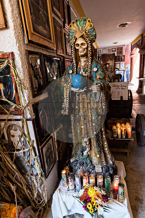 A shrine to the boney lady and offerings inside the La Casa De La Santa Muerte or House of the Saint of the Dead November 1, 2017 in Santa Ana Chapitiro, Michoacan, Mexico.