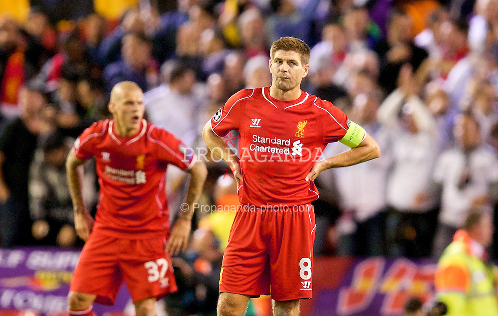 LIVERPOOL, ENGLAND - Wednesday, October 22, 2014: Liverpool's captain Steven Gerrard looks dejected as Real Madrid CF score the second goal during the UEFA Champions League Group B match at Anfield. (Pic by David Rawcliffe/Propaganda)