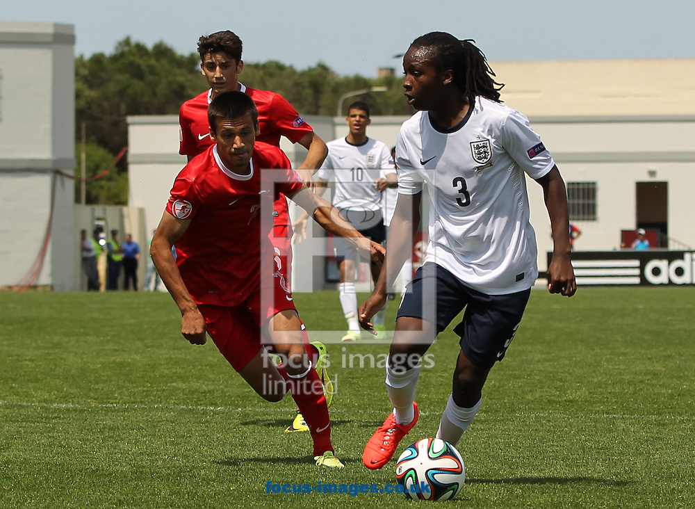 Tafari Moore (right) of England keeps the ball away from Savaş Polat (left) of Turkey during the 2014 UEFA European Under-17 match at Gozo Stadium, Xewkija<br /> Picture by Tom Smith/Focus Images Ltd 07545141164<br /> 12/05/2014