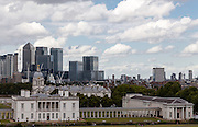 Office building in London's Docklands, including Canary Wharf tower seen above the National Maritime Museum in Greenwich. London, UK Monday August 11h 2014
