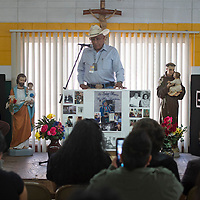 011113      Cayla Nimmo<br /> <br /> Howard Paytiamo shares his memories of his friend, Dr. Alex Seowtewa, during his memorial held at Saint Michael's school in Zuni Saturday afternoon.