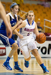 Morgantown guard Sammie Parks (3) drives down the lane against Buckhannon Upshur during a first round game at the Charleston Civic Center.