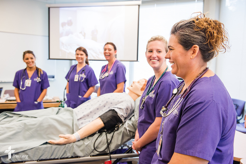 Carley Frost (far right) chats during a nursing orientation session at Concordia University Texas on Wednesday, July 16, 2014, in Austin, Texas. Next to her is Katelyn Norman. LCMS Communications/Erik M. Lunsford
