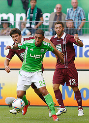 24.09.2011,Volkswagen Arena, Wolfsburg, GER, 1.FBL,VfL Wolfsburg vs 1.FC Kaiserslautern, im Bild Ashkan Dejagah (Wolfsburg #24) setzt sich gegeThanos Petsos (Kaiserslautern #13) und Florian Dick (Kaiserslautern #23) durch .// during the match from GER, 1.FBL, VfL Wolfsburg vs 1.FC Kaiserslautern on 2011/09/24, Volkswagen Arena, Wolfsburg, Germany..EXPA Pictures © 2011, PhotoCredit: EXPA/ nph/  Schrader       ****** out of GER / CRO  / BEL ******