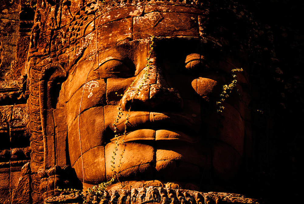 A giant stone face in the Bayon Temple in Angkor, Cambodia. A 12th century temple-mountain complex containing 200 gigantic faces. Image from the book project Man Eating Bugs: The Art and Science of Eating Insects.