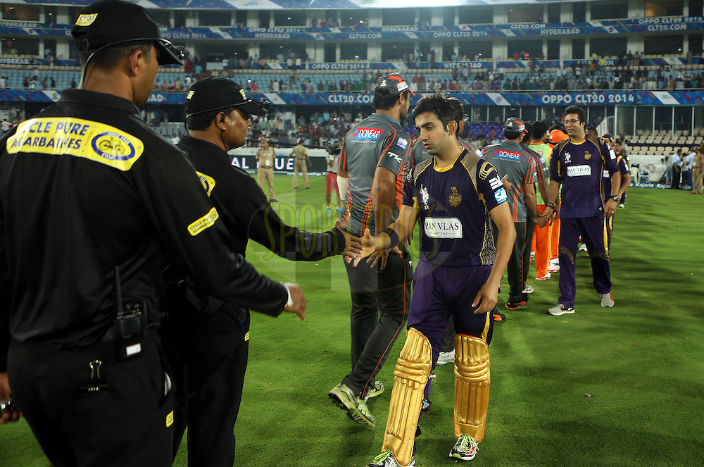 Players of Kolkatta Knight Riders and Players of Lahore Lions shakes hand after the  match 7 of the Oppo Champions League Twenty20 between the Kolkata Knight Riders and the Lahore Lions held at the Rajiv Gandhi Cricket Stadium, Hyderabad, India on the 21st September 2014<br /> <br /> Photo by:  Sandeep Shetty / Sportzpics/ CLT20<br /> <br /> <br /> Image use is subject to the terms and conditions as laid out by the BCCI/ CLT20.  The terms and conditions can be downloaded here:<br /> <br /> http://sportzpics.photoshelter.com/gallery/CLT20-Image-Terms-and-Conditions-2014/G0000IfNJn535VPU/C0000QhhKadWcjYs