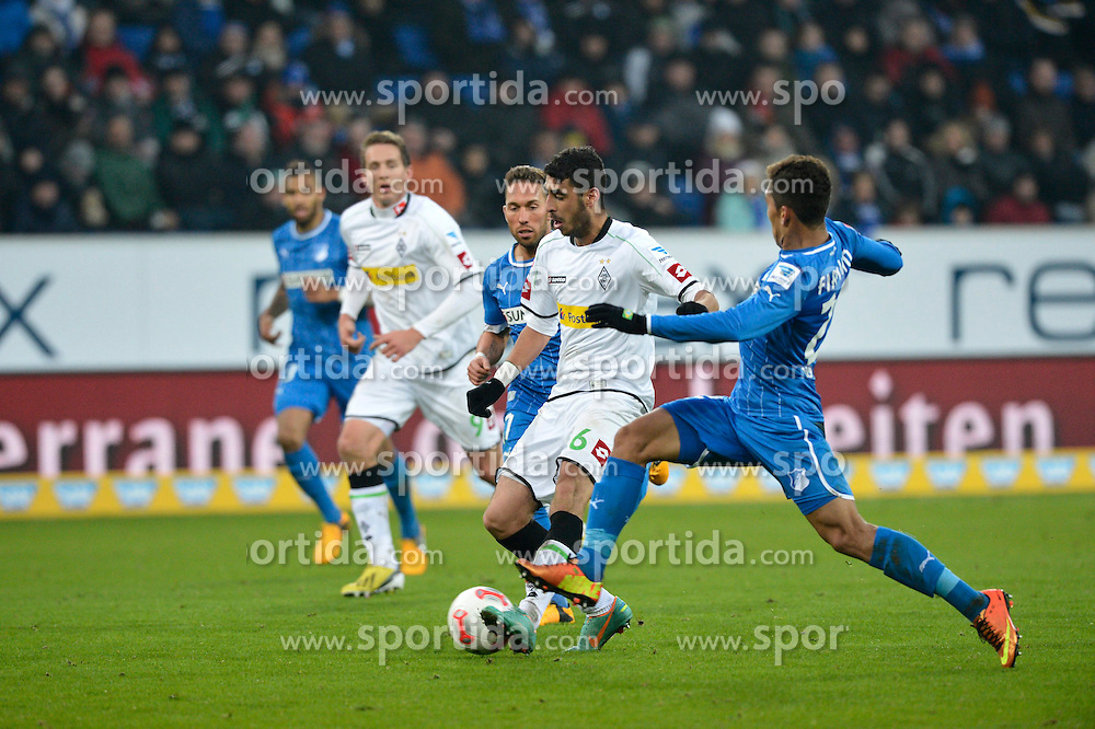 19.01.2013, Rhein Neckar Arena, Sinsheim, GER, 1. FBL, TSG 1899 Hoffenheim vs Borussia Moenchengladbach, 18. Runde, im Bild Tolga CIGERCI Borussia Mönchengladbach Zweikampf Aktion setzt sich durch gegen Roberto FIRMINO TSG 1899 Hoffenheim (rechts) // during the German Bundesliga 18th round match between Bayer 04 Leverkusen and Eintracht Frankfurt at the BayArena, Leverkusen, Germany on 2013/01/19. EXPA Pictures © 2013, PhotoCredit: EXPA/ Eibner/ Weber..***** ATTENTION - OUT OF GER *****