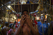 Jan. 24, 2016 - Kuala Lumpur, Batu Caves, Malaysia - <br /> <br /> Thaipusam Festival in Kuala Lumpur<br /> <br /> A Hindu devotee pierced his tongue with metal skewers to take part of the Thaipusam procession in the Batu Caves. To mark this day, Hindus devotees pierce different part of their body with various metal skewers and carry pots of milk on their heads along couple of kilometers to celebrate the honor of Lord Subramaniam (Lord Murugan) in the Batu Caves, one of the most popular shrine outside India and the focal point to celebrate the Thaipusam Festival in Malaysia..Thaipusam is an annual Hindu festival, observed on the day of the full moon during the Tamil month of Thai, it is also a public holiday for many people.<br /> &copy;Exclusivepix Media