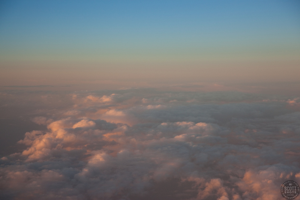 """Sunset Above the Clouds 1"" - This sunset was photographed from an airplane above the clouds."