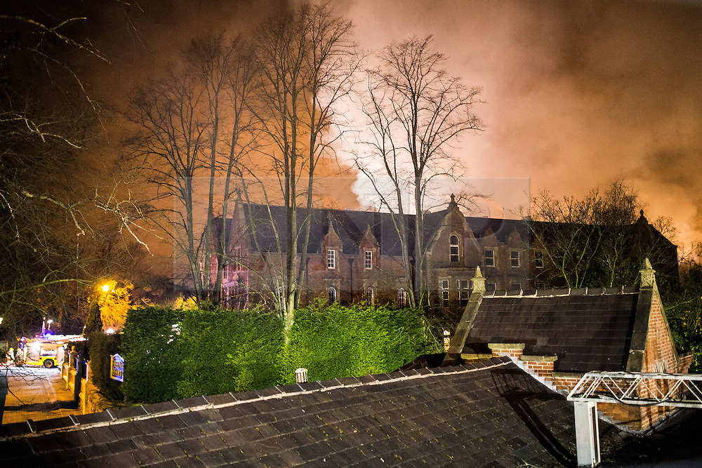 © Licensed to London News Pictures . 13/03/2013 . Alderley Edge , Cheshire , UK . Smoke and flames are visible from several miles around . Famous celebrity nightclub , Panacea , in Alderley Edge , is ablaze tonight (12th March) . Fire crews and police were initially called to the venue at 22:30 on Tuesday night (12th March) . Around 50 fire-fighters from Cheshire and Greater Manchester worked to control the fire at the venue , which is adjacent to a petrol station and residential properties in the affluent village of Alderley Edge . This is the second time in five years the venue has been destroyed by fire , previously following a £3.2 million refurbishment in September 2008 . Photo credit : Joel Goodman/LNP