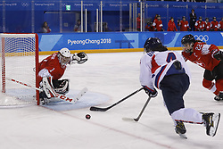 February 18, 2018 - Pyeongchang, KOREA - Switzerland goaltender Janine Alder (1) blocks a shot by Korea forward Un Hyang Kim (4) as Switzerland defenseman Livia Altmann (22) helps in a hockey game between Switzerland and Korea during the Pyeongchang 2018 Olympic Winter Games at Kwandong Hockey Centre. Switzerland beat Korea 2-0. (Credit Image: © David McIntyre via ZUMA Wire)