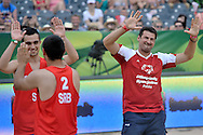Wladimir Grbic of Serbia (R) celebrate a winning point while exhibition match of Special Olympics Poland during Day 7 of the FIVB World Championships on July 7, 2013 in Stare Jablonki, Poland. <br /> <br /> Poland, Stare Jablonki, July 07, 2013<br /> <br /> Picture also available in RAW (NEF) or TIFF format on special request.<br /> <br /> For editorial use only. Any commercial or promotional use requires permission.<br /> <br /> Mandatory credit:<br /> Photo by © Adam Nurkiewicz / Mediasport