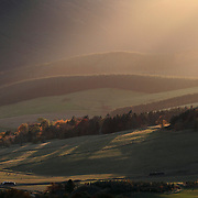 Dusk light over Chapelgill hill in Upper Tweedale over the valley below known as Glenholm