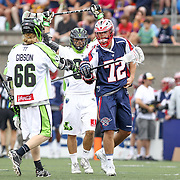 Scott McWilliams #72 of the Boston Cannons greets Matt Gibson #66 of the New York Lizards during the game at Harvard Stadium on July 19, 2014 in Boston, Massachusetts. (Photo by Elan Kawesch)