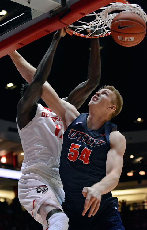 jt120716j/sports/jim thompson/UNM's #11 Obij Aget jams the shot against UTEP's #54 Kelvin Jones.  Wednesday Dec. 07, 2016. (Jim Thompson/Albuquerque Journal)