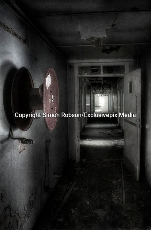 "Abandoned creepy pictures  of inside the former RAF Hospital<br /> used as a place for burns victims during the Second World War.<br /> <br /> Empty hallways and graffitied walls are some of the sights that have been photographed at the former Rauceby Hospital site.<br /> <br /> Photographer Simon Robson has been inside the former mental hospital which was also used as a place for burns victims during the Second World War.<br /> <br /> Mr Robson, who is from Lincoln, said he wanted to photograph the site because it was a former asylum. He said: ""I like the idea of going round a former asylum as it has more character about it.<br /> <br /> ""It was gutted on the inside, there were empty rooms and no furniture.<br /> He added an old hospital bed was something that he will remember from the site.<br /> <br /> ""When I went in the old chapel part there was an old hospital bed left in there which was quite creepy at the time.<br /> <br /> ""I don't think about where I am too much and stay in my own world of photography.""<br /> <br /> The hospital originally opened in 1902 and the buildings included a chapel, two graveyards, a mortuary, and various tunnels connecting wards.<br /> The South Lincolnshire Community and Mental Health Services NHS Trust closed the main hospital building in 1997, but kept on Orchard House as the Trust's headquarters.<br /> <br /> Mr Robson added: ""I think it's places where people don't get to see inside that are fascinating - it's a fascination with the unknown.""<br /> <br /> The 35-year-old from Lincoln said he was inspired to photograph places such as the former Rauceby Hospital site after seeing other photographs on online forums.<br /> <br /> He added that he always been interested in photography it was the subject of his degree, but admits it's more of a hobby for him now.<br /> ©Simon Robson/Exclusivepix Media"