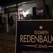 A sign is posted in front if Ted's Fun on the River Tuesday November 4, 2014 for the election night results party of Elizabeth Redenbaugh in Wilmington, N.C. (Jason A. Frizzelle)