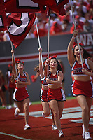 Wolfpack cheerleaders run across the end zone in celebration of a touchdown.