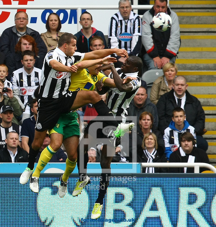 Picture by Paul Chesterton/Focus Images Ltd +44 7904 640267.23/09/2012.Russell Martin of Norwich is sandwiched between Steven Taylor of Newcastle and Demba Ba of Newcastle during the Barclays Premier League match at the Sports Direct Arena, Newcastle.