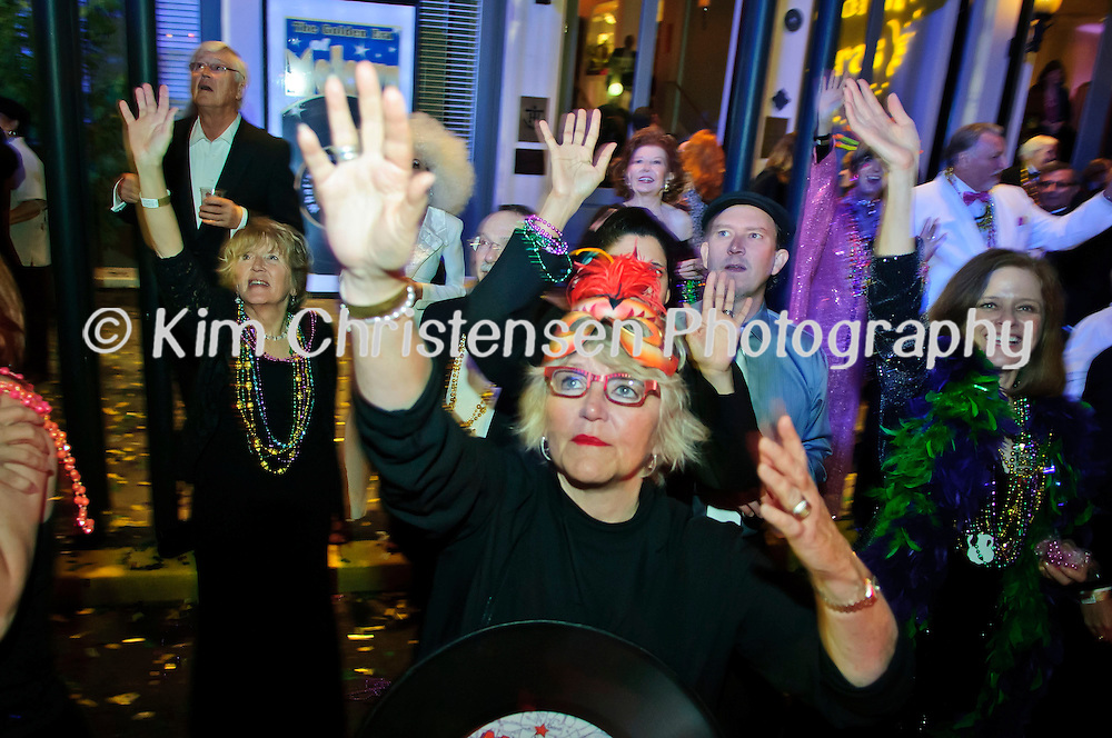 "Ann Simmons and others enjoy catching beads outside The Tremont House Mardi Gras celebrate ""The Golden Era of Motown"" ball."