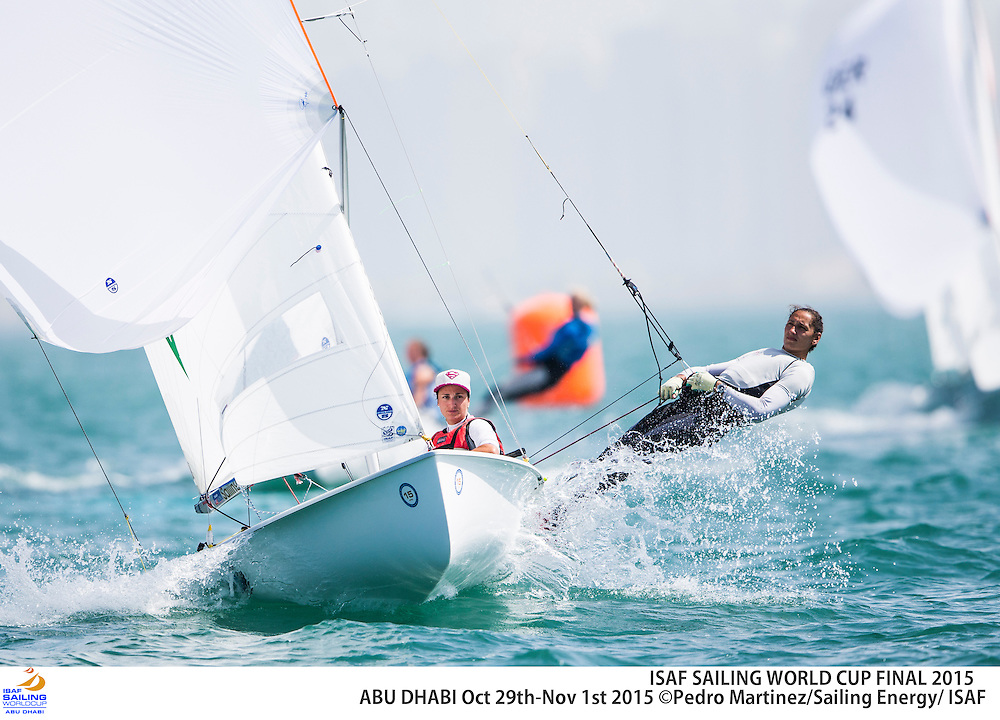 Local sailing school and olympic sailors together sailing optimist. 2015 ISAF Sailing World Cup Final, Abu Dhabi, United Arab Emirate. Eight Olympic sailing events are being contested along with open kiteboarding from 29th October to November 1st, 2015. Prize money will be awarded to the top three overall finishers in each of the events for a total prize purse of US$220,000. The Abu Dhabi Sailing and Yacht Club is the host of the ISAF Sailing World Cup Final, located on the main island of the city with immediate access to the beautiful waters of the Arabian Gulf.  Race areas are placed around Lulu Island off the UAE capital&rsquo;s stunning Corniche.<br /> <br /> Credit Pedro Martinez/Sailing Energy/ Isaf