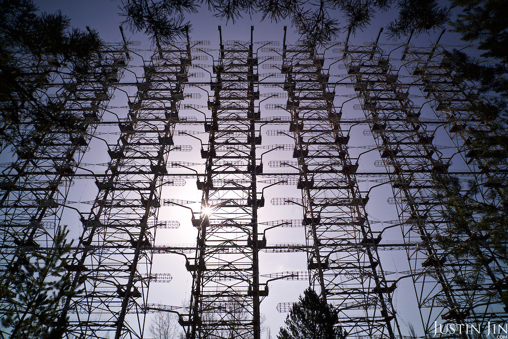 The &quot;Russian Woodpecker&quot;, an advanced Soviet radio weapon, stands near the decommissioned Chernobyl power station reactor number 4. <br /> <br /> Дуга-3 (Duga-3) was a Soviet over-the-horizon (OTH) radar system used as part of the Soviet ABM early-warning network. The system operated from July 1976 to December 1989. Two operational Duga radars were deployed, one near Chernobyl and Chernihiv in what was then called the Ukrainian SSR (present-day Ukraine), the other in eastern Siberia.<br /> <br /> The Duga systems were extremely powerful, over 10 MW in some cases, and broadcast in the shortwave radio bands. They appeared without warning, sounding like a sharp, repetitive tapping noise at 10 Hz,[1] which led to it being nicknamed by shortwave listeners the Russian Woodpecker. The random frequency hops disrupted legitimate broadcast, amateur radio, commercial aviation communications, utility transmissions, and resulted in thousands of complaints by many countries worldwide. <br /> <br /> 30 years on, the Chernobyl power plant is still heavily contaminated, unfit for human life. <br /> <br /> The Chernobyl nuclear disaster happened on 26 April 1986.