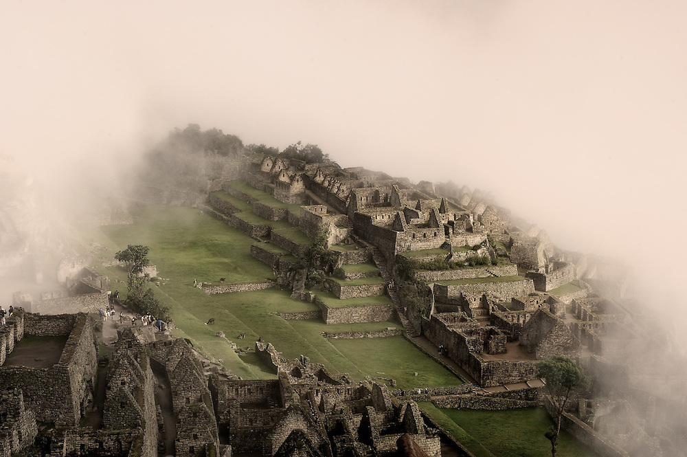 Machu Picchu wrapped in clouds, peeking through for a moment. The Incas did incredible building in the short time that they ruled Peru before the coming of the Spanish. <br /> <br /> &copy;Jim Richardson  All rights reserved<br /> <br /> You can see more of my photography at www.jimrichardsonphotography.com
