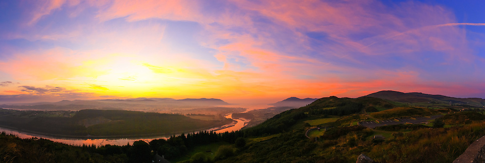 Sunrise from Flagstaff Viewpoint shortly before official sunrise overlooking The Mourne Mountains, Carlingford Lough, Slieve Foy, Warrenpoint, the Newry River and Narrow Water Wood made up of 10 images at 18mm