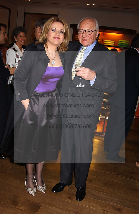 Singer RENEE FLEMING and SIR RONALD GRIERSON at a dinner hosted by Asprey at their store at 167 New Bond Street, London W1 on 12th July 2005.<br />
