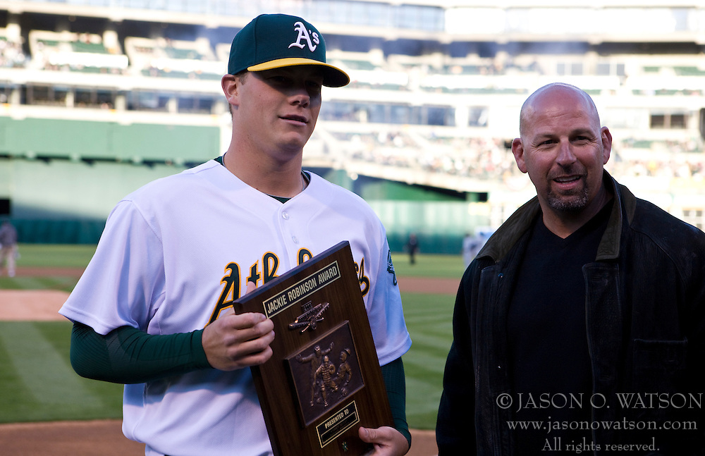 April 5, 2010; Oakland, CA, USA;  Former Oakland Athletics player Walt Weiss (right) presents the Jackie Robinson Award for the 2009  American League Rookie of the Year to Oakland Athletics relief pitcher Andrew Bailey (40) before the game against the Seattle Mariners at Oakland-Alameda County Coliseum. Seattle defeated Oakland 5-3.