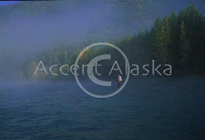 Alaska. Kenai Peninsula. Flyfisherman in the early morning fog.