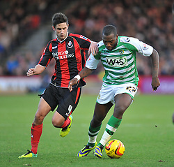 Bournemouth's Andrew Surman battles for the ball with Yeovil Town's Ishmael Miller - Photo mandatory by-line: Alex James/JMP - Tel: Mobile: 07966 386802 26/12/2013 - SPORT - FOOTBALL - Goldsands Stadium - Bournemouth - AFC Bournemouth v Yeovil Town - Sky Bet Championship