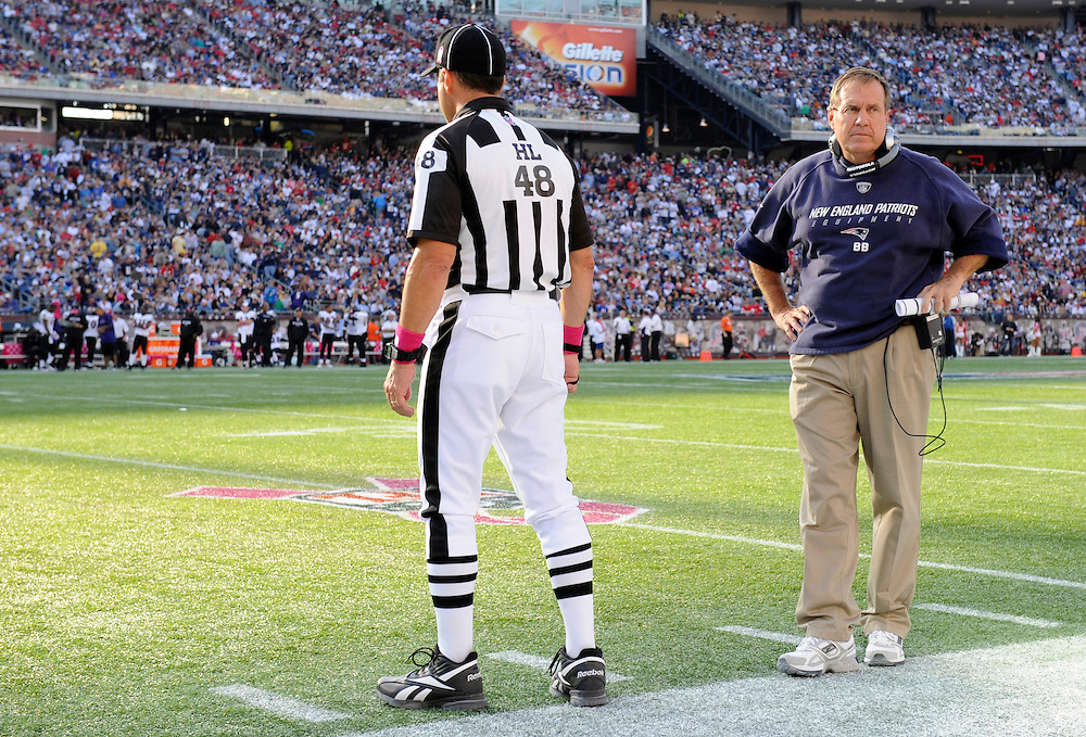 FOXBORO, MA - OCTOBER 04: Head Coach Bill Belichick of the New England Patriots looks on with referee Jim Mello against the Baltimore Ravens at Gillette Stadium on October 4, 2009 in Foxboro, Massachusetts. The Patriots defeated the Ravens 27 to 21. (Photo by Rob Tringali) *** Local Caption *** Bill Belichick;Jim Mello