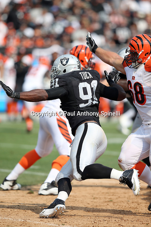 Oakland Raiders defensive end Justin Tuck (91) pushes his way past Cincinnati Bengals guard Kevin Zeitler (68) as he rushes the quarterback during the 2015 NFL week 1 regular season football game against the Cincinnati Bengals on Sunday, Sept. 13, 2015 in Oakland, Calif. The Bengals won the game 33-13. (©Paul Anthony Spinelli)