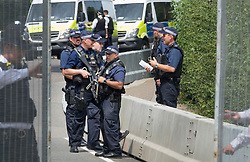 © Licensed to London News Pictures. 12/07/2018. London, UK. Armed police patrol inside a perimeter fence inside Regent's Park at the US Ambassador's residence where President Trump will stay later.  Photo credit: Peter Macdiarmid/LNP