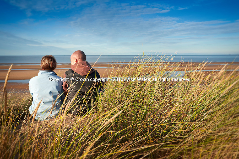 Family (parents and young son) walking<br /> Gronant Dunes<br /> Wales Coast Path<br /> Flintshire<br /> North<br /> Walking<br /> Activities and Sports