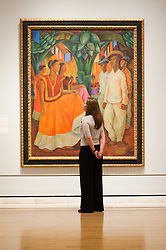 """Mexico: A Revolution in Art opens at the Royal Academy of Arts.<br /> A employee stands next to work by Diego Rivera entitled """"Dance in Tehuantepec, 1928"""" at the exhibition """"Mexico: A Revolution in Art, 1910 - 1940"""" which opens at the Royal Academy of Arts on the 6th of July. The show features over 120 paintings and photographs and examines the intense period of artistic creativity that took place in Mexico at the beginning of the 20th century,<br /> London, United Kingdom,<br /> Tuesday, 2nd July 2013<br /> Picture by Piero Cruciatti / i-Images"""