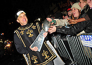 New Orleans Saints Head Coach and winning Super Bowl Champion Sean Payton holds the Lombardi Trophy as he struts down canal Street  for City of New Orleans Super winning New Orleans Saints fans can touch the Super Bowl Trophy..in front of The Palace cafe during the Orpheus Mardi Gras Parade Monday Feb. 15, 2010. Photo © Suzi Altman/SuziSnaps