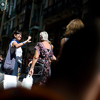 Local women talk in a street of the Northern Spanish Basque city of Bilbao, on August 25, 2011. Photo Rafa Rivas