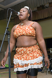 Female singer from the Hohodza band (www,hohodzaband,co,uk) performing on stage at a Diversity day event; Nottingham,
