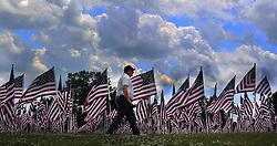 May 29, 2017 - Cincinnati, Ohio, U.S - A man make his way around the 800 flags on display as part of the Memorial Day events in Cincinnati,Ohio . That is part of the Field of Dreams Memorial event a the Arlington Memorial Gardens on Mon May 29,2017. (Credit Image: © Ernest Coleman via ZUMA Wire)