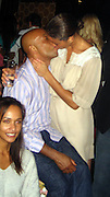 **EXCLUSIVE**.Russel Simmons gets very affectionate with his girlfriend Porschla Coleman at Lenny Kravitz new Miami bar The Florida Room, after his Rush Philanthropic event at The Delano Hotel.Miami Beach, FL, USA.Thursday, December 06, 2007 .Photo By Celebrityvibe.com.To license this image please call (212) 410 5354; or.Email: celebrityvibe@gmail.com ;.website: www.celebrityvibe.com