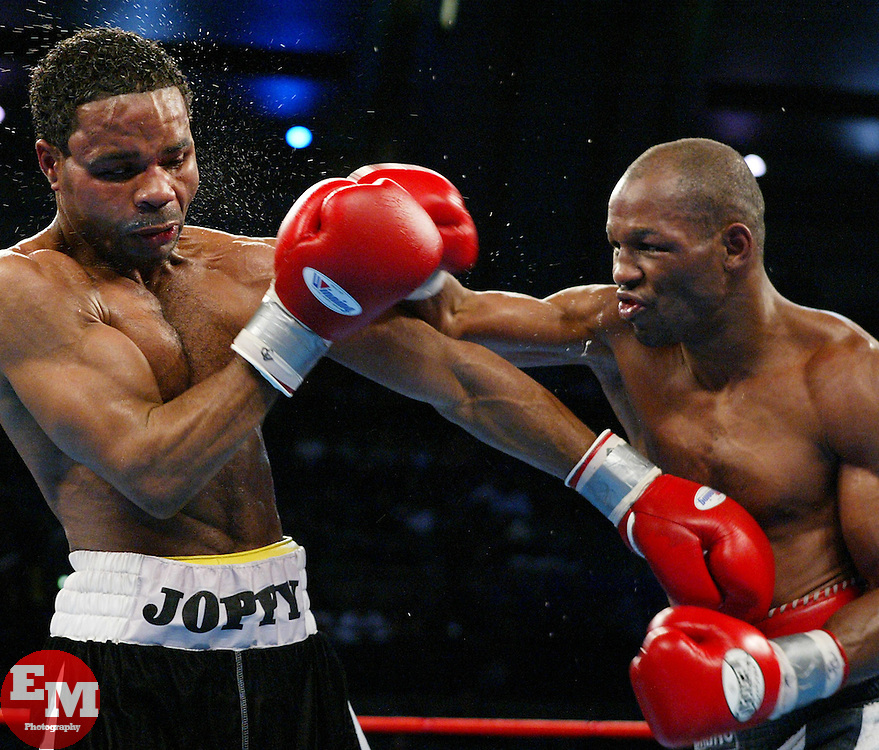 December 13, 2003; Atlantic City, NJ; USA; World Middleweight Champion Bernard Hopkins (r) lands a right hand to the head of challenger William Joppy (l) during their bout at Boardwalk Hall in Atlantic City, NJ.