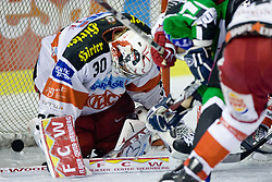 Rene Swette (EC KAC, #30) and puck in the net during ice-hockey match between HDD Tilia Olimpija and EC KAC in 12th Round of EBEL league, on October 17, 2010 at Hala Tivoli, Ljubljana, Slovenia. (Photo By Matic Klansek Velej / Sportida.com)
