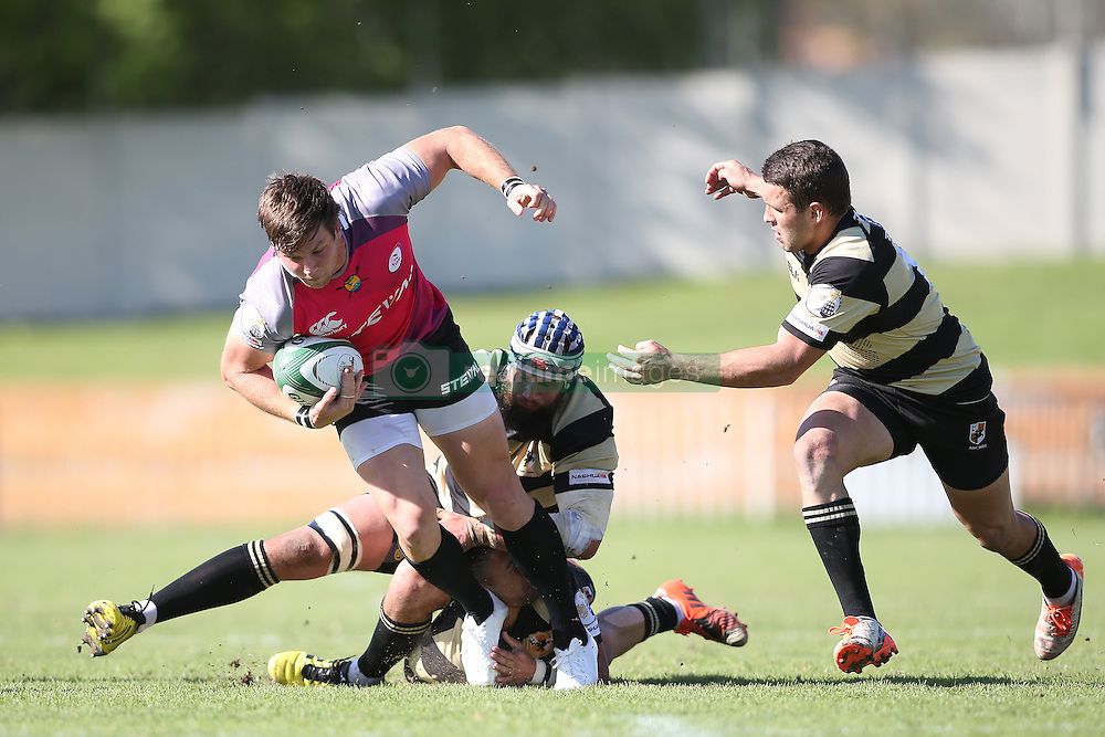 Tyler Fisher of the Pumas slips through the tackle during the Currie Cup premier division match between the Boland Cavaliers and The Pumas held at Boland Stadium, Wellington, South Africa on the 2nd September 2016<br /> <br /> Photo by:   Shaun Roy/ Real Time Images