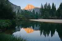 Half Dome reflected in Merced River Yosemite National Park California USA.