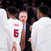 January 9, 2018, New York, NY : St. John's head coach Chris Mullin speaks with his players courtside during Tuesday night's matchup between the Hoyas and Red Storm at the Garden. In something of a rematch of their 1985 contest, Basketball greats Patrick Ewing and Chris Mullin returned to Madison Square Garden on Tuesday night to face off as coaches with their respective Georgetown and St. John's teams.  CREDIT: Karsten Moran for The New York Times
