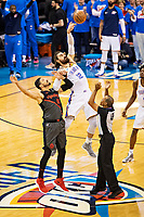 OKLAHOMA CITY, OK - APRIL 21: Steven Adams #12 of the Oklahoma City Thunder wins the tip off against Enes Kanter #00 of the Portland Trail Blazers during Round One Game Three of the 2019 NBA Playoffs on April 21, 2019 at Chesapeake Energy Arena in Oklahoma City, Oklahoma  NOTE TO USER: User expressly acknowledges and agrees that, by downloading and or using this photograph, User is consenting to the terms and conditions of the Getty Images License Agreement.  The Trail Blazers defeated the Thunder 111-98.  (Photo by Wesley Hitt/Getty Images) *** Local Caption *** Steven Adams; Enes Kanter