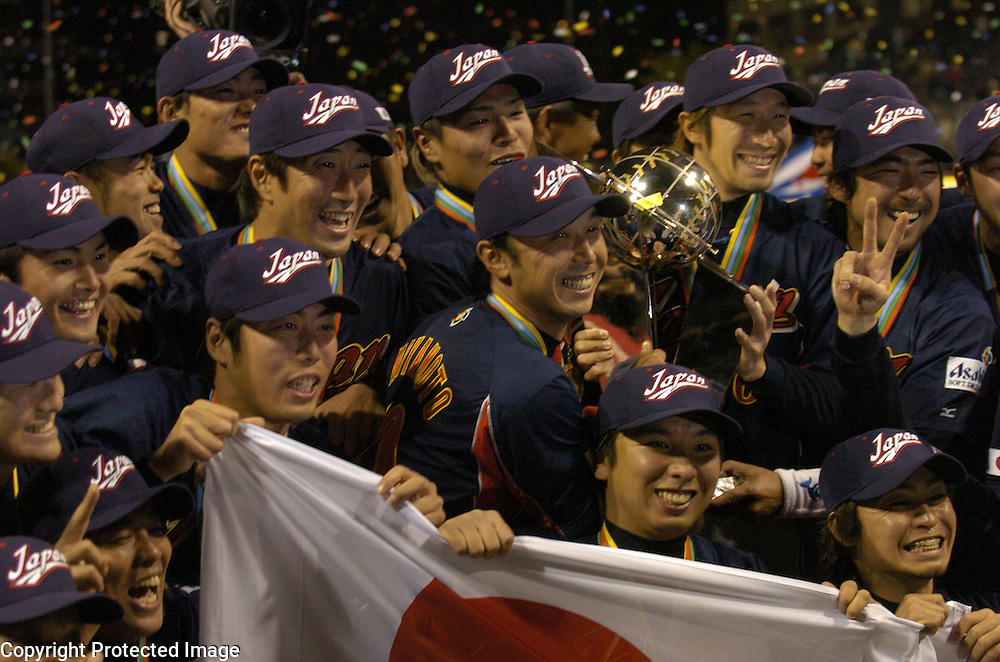 Team Japan celebrates with the Championship Trophy after beating Team Cuba 10-6 in Final action of the World Baseball Classic at PETCO Park, San Diego, CA.